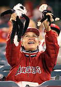 ANAHEIM, CA - APRIL 15:  A fan waves her rally monkeys during the Los Angeles Angels of Anaheim game against the Oakland Athletics at Angel Stadium on Tuesday, April 15, 2014 in Anaheim, California. The Athletics won the game 10-9 in eleven innings. (Photo by Paul Spinelli/MLB Photos via Getty Images)