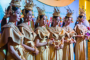 24 JUNE 2014 - BANGKOK, THAILAND: Thai women in the welcoming group wait to participants to arrive at the the 6th Asian Ministerial Conference on Disaster Risk Reduction (AMCDRR). The AMCDRR started in Bangkok on June 24. The first of the biennial conferences was held in Beijing in 2005 after the 2004 Asian Tsunami and H5N1 Bird Flu epidemic of 2004. The conference this year in Bangkok will focus on possible disasters related to climate change, sustainable development, and managing public private partnerships for disaster risk.     PHOTO BY JACK KURTZ