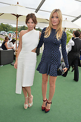 Left to right, ANNA FRIEL and LAURA WHITMORE at the St.Regis International Polo Cup at Cowdray Park, Midhurst, West Sussex on 17th May 2014.