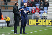 Wigan Athletic Manager Paul Cook debates the decision with Fourth official Carl Boyeson  during the EFL Sky Bet Championship match between Wigan Athletic and Nottingham Forest at the DW Stadium, Wigan, England on 20 October 2019.