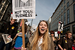 © licensed to London News Pictures. London, UK 14/03/2012. Protesters are marching at the student demonstration against tuition fees and education cuts today in central London. Photo credit: Tolga Akmen/LNP
