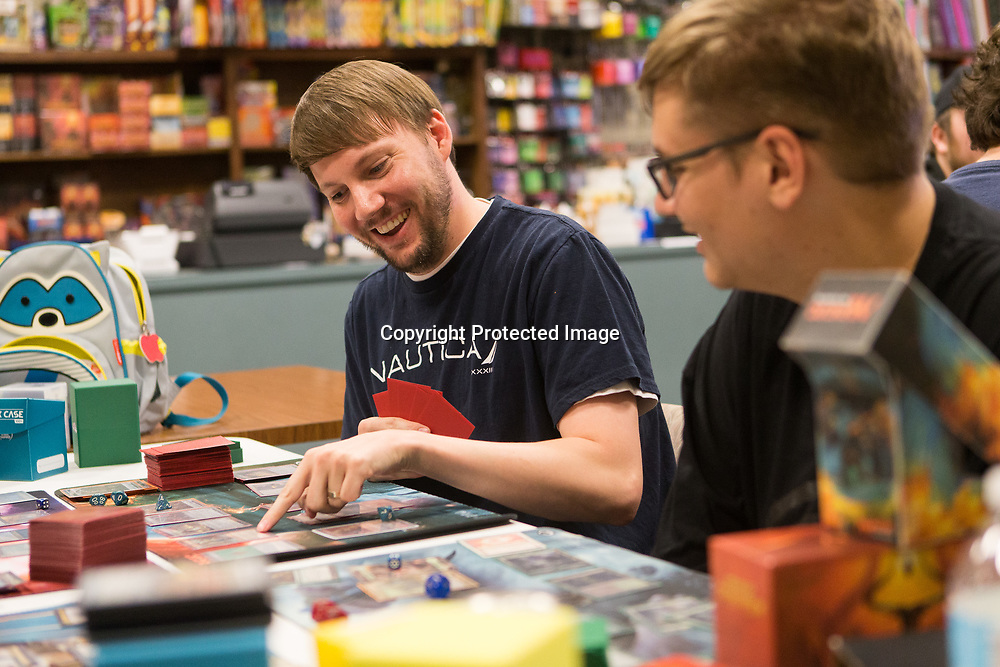 Martin Hayes points to a card as he plays Magic: The Gathering Tuesday night at Tupelo Sportscards and Games. Hayes was playing with a mono-red deck, which has cards that use red 'mana' to play character cards.