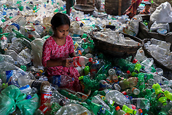 March 27, 2019 - Dhaka, Bangladesh - A girl is working in a Plastic recycling factory in Dhaka Bangladesh on March 28, 2019. (Credit Image: © Kazi Salahuddin Razu/NurPhoto via ZUMA Press)