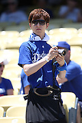 LOS ANGELES, CA - JULY 13:  A fan takes a picture before the Los Angeles Dodgers game against the San Diego Padres at Dodger Stadium on Sunday, July 13, 2014 in Los Angeles, California. The Dodgers won the game 1-0. (Photo by Paul Spinelli/MLB Photos via Getty Images)