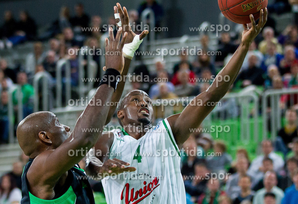 Uche Nsonwu #5 of Asvel Villeurbanne Basket vs Cedric Jackson #4 of KK Union Olimpija during basketball match between KK Union Olimpija Ljubljana and Asvel Villeurbanne Basket (FRA) in Round 7 of EuroCup 2013/14, on November 27, 2013 in Arena Stozice, Ljubljana, Slovenia. Photo by Vid Ponikvar / Sportida