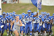 Water Valley's Derrick Brady (80) leads the team onto the field vs. New Albany at Bobby Clark Field in Water Valley, Miss. on Friday, August 22, 2014. Water Valley won the season opener 36-33.