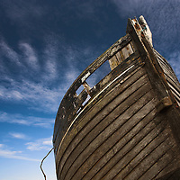 Boat on Dungeness beach with blue sky