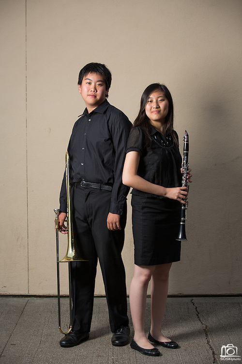 Edgar Xiong, MHS sophomore, left, and Amanda Le, MHS senior, pose for a portrait with their instruments before performing in the Milpitas Unified School District's 11th Annual Music Festival at Milpitas High School in Milpitas, California, on April 10, 2014. (Stan Olszewski/SOSKIphoto)