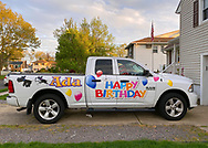 Seaford, New York, U.S.  May 5, 2020. JOEY CESTARE decorates his truck and makes sign with 'Happy Birthday Ada, Thank You for being our Hero!' and 2 schnauzers, for friend, nurse Ada Cea, a COVID-19 frontline healthcare worker at North Shore University Hospital, Northwell Health, on Long Island, during novel coronavirus pandemic. Cestare will drive truck to hotel where Cea is staying to avoid exposing her parents to virus.