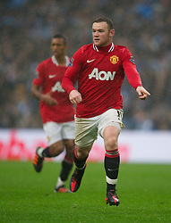 MANCHESTER, ENGLAND - Sunday, January 8, 2012: Manchester United's Wayne Rooney in action against Manchester City during the FA Cup 3rd Round match at the City of Manchester Stadium. (Pic by David Rawcliffe/Propaganda)