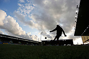 Burnley players warm up under a dramatic evening sky during the EFL Cup match between Burnley and Sunderland at Turf Moor, Burnley, England on 28 August 2019.