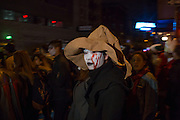 New York, NY - October 31, 2015. A woman in a floppy witch hat and bleeding face.
