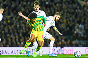 Leeds United midfielder Mateusz Klich (43) tackles West Bromwich Albion forward Matheus Pereira (12) during the EFL Sky Bet Championship match between Leeds United and West Bromwich Albion at Elland Road, Leeds, England on 1 October 2019.