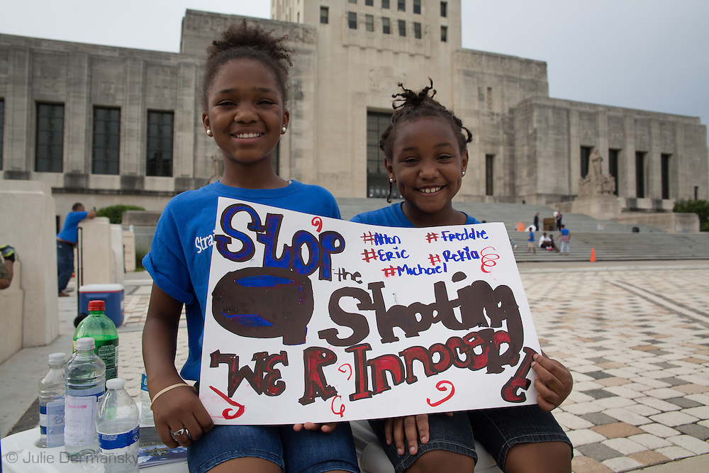 Children on the steps of the Louisiana State Capitol Building during a rally on Sunday, July 10, 2016. About 1000  people turned out to a rally and march in Baton Rouge, LA in response to the police killing of Alton Sterling.