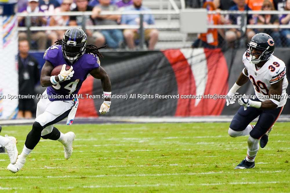BALTIMORE, MD - OCTOBER 15: Baltimore Ravens running back Alex Collins (34) runs the ball against Chicago Bears free safety Eddie Jackson (39) on October 15, 2017, at M&T Bank Stadium in Baltimore, MD.  (Photo by Mark Goldman/Icon Sportswire)