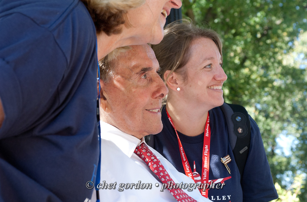 Former U.S. Senator Bob Dole (R-Kan, center) greets WWII Veterans and their escorts at the WWII Memorial in Washington, DC during their Hudson Valley Honor Flight on Saturday, September 27, 2014. Nearly one hundred WWII Veterans from the Hudson Valley region of New York toured the WWII Memorial in Washington, DC and Arlington National Cemetery in Arlington, VA.  © www.chetgordon.com