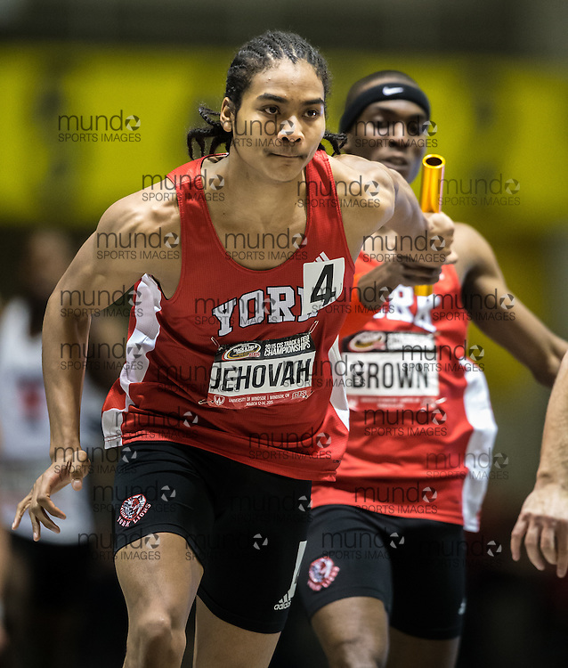 Windsor, Ontario ---2015-03-14---  Xavier Jehovah of York University receives the baton from teammate Jameel Brown during their 4X200m relay final at the 2015 CIS Track and Field Championships in Windsor, Ontario, March 14, 2015.<br /> GEOFF ROBINS/ Mundo Sport Images