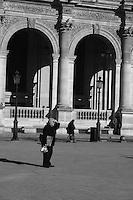Man walking by the Louvre, Paris, France<br />