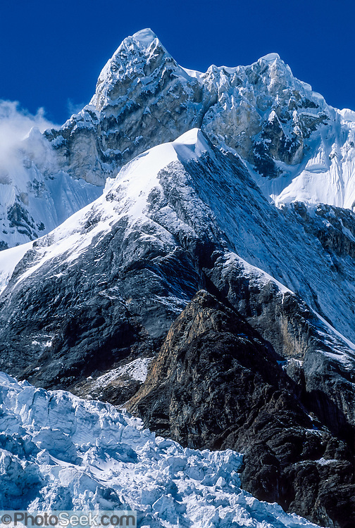 "Glaciers flow from Mount Jirishanca, or the ""Icy Beak of the Hummingbird"" (west face, 6126 m or 20,098 feet elevation), third highest in the Cordillera Huayhuash, tenth highest in Peru. Andes Mountains, South America."