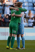 Coventry City goalkeeper Lee Burge (1) and Coventry City defender Nathan Clarke (7) celebrate the win 1-0 during the EFL Sky Bet League 1 match between Coventry City and Bristol Rovers at the Ricoh Arena, Coventry, England on 25 March 2017. Photo by Alan Franklin.