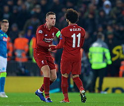 LIVERPOOL, ENGLAND - Tuesday, December 11, 2018: Liverpool's captain Jordan Henderson celebrates with goal-scorer Mohamed Salah after beating SSC Napoli 1-0 and progressing to the knock-out phase during the UEFA Champions League Group C match between Liverpool FC and SSC Napoli at Anfield. (Pic by David Rawcliffe/Propaganda)