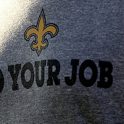 """July 29, 2012; Metairie, LA, USA; New Orleans Saints personnel are seen wearing a """"Do Your Job"""" slogan t-shirt the phrase is what head coach Sean Payton told the team before beginning his one year suspension during a training camp practice at the team's practice facility. Mandatory Credit: Derick E. Hingle-US PRESSWIRE"""