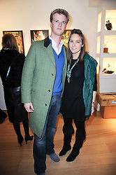 HENRY SMITH and SERENA HAWKINS at a private view of recent paintings, drawings and prints by Dione Verulam (Countess of Verulam) held at Sladmore Contemporary art gallery, 32 Bruton Place, London on 10th February 2010.