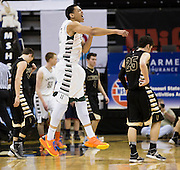 Lafayette's Xavier Kurth (11) reacts after the Fighting Irish win Friday's Class 4 semifinal against the Farmington Knights during the 2014 Show-Me Showdown at Mizzou Arena on March 21, 2014 in Columbia. The Irish defeated the Knights 46-41. (David Welker | Special to the News-Press)