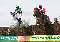 LIVERPOOL, ENGLAND - Thursday, April 8, 2010:Nacarat ridden by Anthony McCoy and Carruthers (R) ridden by Mattie Batchelor during the Totesport Bowl Steeple Chase during the opening day of the Grand National Festival at Aintree Racecourse. (Pic by David Rawcliffe/Propaganda)