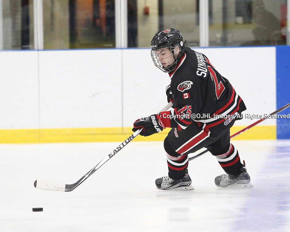 MILTON, ON - Oct 23, 2015 : Ontario Junior Hockey League game action between Kingston and Milton. Artem Suyargulov #25 of the Milton Ice Hawks follows skates with the puck during the second period.<br /> (Photo by Tim Bates / OJHL Images)