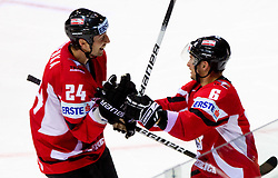 Darcy Werenka of Austria and Rafael Rotter of Austria celebrate during ice-hockey match between Austria and Slovenia of Group G in Relegation Round of IIHF 2011 World Championship Slovakia, on May 7, 2011 in Orange Arena, Bratislava, Slovakia. Austria defeated Slovenia 3-2. (Photo By Vid Ponikvar / Sportida.com)