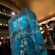 February 12, 2015 - New York, NY : Patrons of the New York City Ballet including, from right, Kevin Clark and Cassiope Sydoriak view artist Dustin Yellin's 'Psychogeographies,' a set of 15 sculptural collages/paintings in the David H. Koch Theater at Lincoln Center on Thursday evening. Yellin made the works for New York City Ballet's 2015 Art Series. CREDIT: Karsten Moran for The New York Times