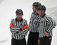 Referee Andrew Wilk (from left) talks with Linesmen Dan Cohen and Linesmen Andy Bethman during the game at the Cedar Rapids Ice Arena, 1100 Rockford Road SW in Cedar Rapids on Saturday evening, February 18, 2012. (Stephen Mally/Freelance)