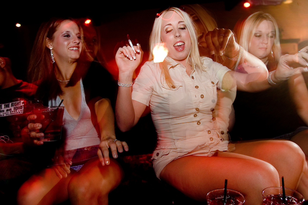 """Carissma Lynn, center, and other sex workers from the Moonlite Bunny Ranch party at Dennis Hof's nightclub in Mound House, NV on Wednesday, July 26, 2006...The Moonlite Bunny Ranch brothel in Mound House, Nevada - just a few miles from the state capital in Carson City - first opened in 1955. The Ranch is a legal, licensed brothel owned by Dennis Hof. It's featured in the HBO series """"Cathouse."""""""