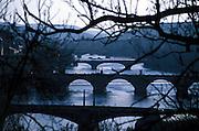 """Die Moldau, sowie drei Prager Brücken, welche das Stadtzentrum mit der """"Kleinseite"""" (Mala Strana) verbinden. Gesehen vom Petrin Berg. In der Mitte die Karlsbrücke.<br /> <br /> River Moldau (Vltava) and three bridges which connect the Prague center with the """"small side"""" (Mala Strana) seen from Petrin hill. In the middle Charles Bridge."""