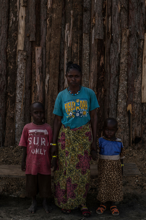 SEBAGORO, UGANDA - MARCH 22: Vomulia Yeruse and her children David, 6 and Christine, 3 in Sebagoro, Uganda on March 22, 2018. The family fled violence in Ituri Province in northeastern Democratic Republic of Congo which has displaced more than 100,000 people including approximately 40,000 refugees who have fled to Uganda. (Photo by Andrew Renneisen for The Washington Post)