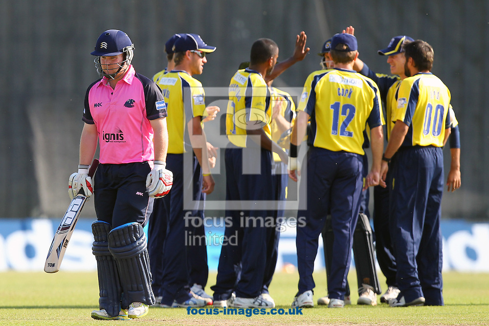 Picture by James Ward/Focus Images Ltd. 07908 205049 .1/7/11.Paul Stirling of MIddlesex leaves the field after being caught by Mascarenhas of Hampshire during the Friends Life T20 match at Uxbridge Cricket Club.