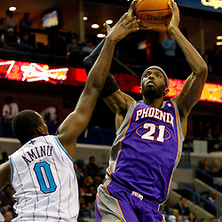 December 30, 2011; New Orleans, LA, USA; Phoenix Suns power forward Hakim Warrick (21) shoots over New Orleans Hornets small forward Al-Farouq Aminu (0) during the second half of a game at the New Orleans Arena. The Suns defeated the Hornets 93-78.   Mandatory Credit: Derick E. Hingle-US PRESSWIRE