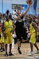 Guildford, England, Sunday 21st March 2010:  Andrew Bridge of Newcastle jumps to score past Shawn Myers (7) of Cheshire during the  BBL Trophy Final between Cheshire Jets and Newcastle Eagles at the Guildford Spectrum, Surrey, UK. Final score Cheshire 95-111 Newcastle.  (photo by Andrew Tobin/SLIK images)