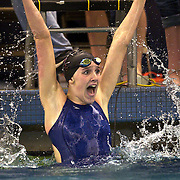 Hailey Shand of Park City High School celebrates her first place finish in the 100 Yard Backstroke in the 3A Swimming Championships on the BYU campus in Provo, Utah, Saturday, Feb. 6, 2010. August Miller, Deseret News .