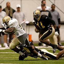 08 August 2009: Cornerback Jabari Greer (32) tackles running back P.J. Hill (43) as Roman Harper (41) trails on the play during the New Orleans Saints annual training camp Black and Gold scrimmage held at the team's indoor practice facility in Metairie, Louisiana.
