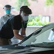 Appointment only testing for Coronavirus (Covid-19) has begun in the University of Central Florida parking garage lot A on Monday, April 6, 2020 in Orlando, Florida. (Alex Menendez via AP)