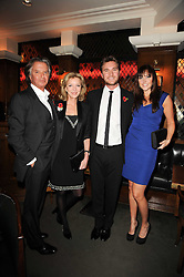 Left to right, RICHARD CARING, his wife JACKIE, BEN CARING and his wife ELLE at 'Heavenly Ivy' a play to commemorate 20 years of The Ivy Restaurant, held at The Ivy, West Street, London on 8th November 2010.