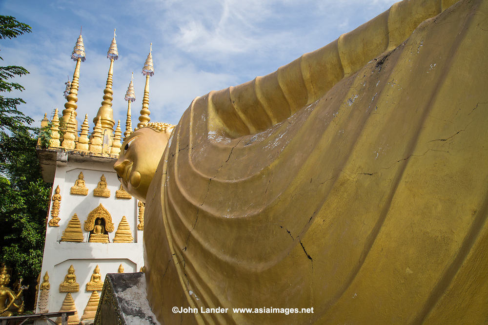 Wat Phong Sunan is a Thai temple with a reclining Buddha image. The temple was the family sponsored temple of the Vongburi family, whose famous teak mansion is nearby.
