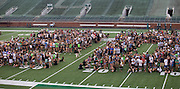 Students wait on the field of Peden Stadium for the Class of 2020 photo to be taken on Saturday, August 20, 2016. ©Ohio University / Photo by Kaitlin Owens