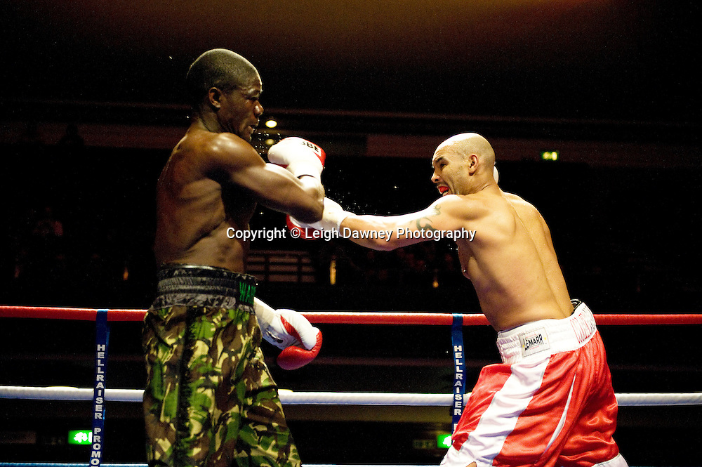 J J Ojvejerie (red shorts) v Hastings Rasani at Watford Colusseum 29 November 2009 Promoter Mickey Helliet, Hellraiser Promotions: Credit: ©Leigh Dawney Photography