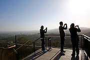 Visitors take pictures from a vantage point at Griffith Observatory in Los Angeles May 13. The town of the Queen of the Angels, later known as simply Los Angeles, was established by the Spanish in September of 1781. It was located just west of Mission San Gabriel, which Blessed Junipero Serra founded 10 years earlier in 1771. © 2015 Nancy Wiechec