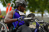 July 4th, 2006:  Anchorage, Alaska - James McGilberry (554), Army veteran from Banning, Calif, exits turn one of the 5k handcycle event at the 26th National Veterans Wheelchair Games.