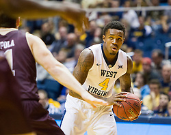 Dec 13, 2015; Morgantown, WV, USA; West Virginia Mountaineers guard Daxter Miles Jr. (4) looks to pass to a teammate during the first half against the Louisiana Monroe Warhawks at WVU Coliseum. Mandatory Credit: Ben Queen-USA TODAY Sports