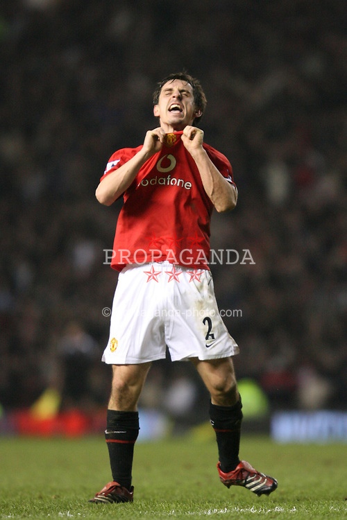 MANCHESTER, ENGLAND - SUNDAY, JANUARY 22nd, 2006: Manchester United's Gary Neville runs the length of the field to scream obscenities at the Liverpool fans, clear incitement that the police should investigate, after the winning goal during the Premiership match at Old Trafford. (Pic by David Rawcliffe/Propaganda)
